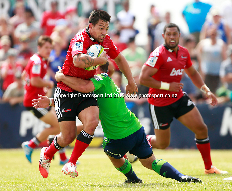 Rob Thompson of the Crusaders is tackled by John Hardie of the Highlanders during the Investec Super Rugby pre season game between Crusaders v Highlanders at Alpine Energy Stadium, Timaru. 24 January 2015 Photo: Joseph Johnson/www.photosport.co.nz