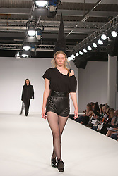 © Licensed to London News Pictures. 01/06/2014. London, England. Collection by Sally Chennery from UCA Epsom Fashion - university for the creative arts. Graduate Fashion Week 2014, Runway Show at the Old Truman Brewery in London, United Kingdom. Photo credit: Bettina Strenske/LNP