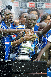 LONDON, ENGLAND - Saturday, May 17, 2008: Portsmouth's Nwankwo Kanu and Papa Bouba Diop celebrate with the trophy after their 1-0 victory over Cardiff City during the FA Cup Final at Wembley Stadium. (Photo by David Rawcliffe/Propaganda)