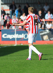 Cheltenham Town's Jack Deaman appeals to the fourth official after his shirt is ripped - Photo mandatory by-line: Nizaam Jones - Mobile: 07966 386802 - 06/04/2015 - SPORT - Football - Cheltenham - Whaddon Road - Cheltenham Town v Stevenage - Sky Bet League Two