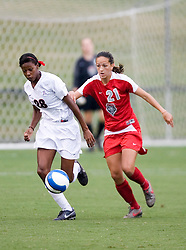 Arizona Wildcats MF/F Jasmin Day (28) battles with New Mexico Lobos MF Terryn Granados (21)..The New Mexico Lobos faced the Arizona Wildcats in the first game of the 2007 Nike Soccer Classic held at Klockner Stadium in Charlottesville, VA on August 14, 2007.  The Wildcats defeated the Lobos 4-1.