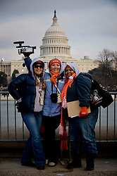 Students from Pitzer College in Claremont, California pose in front of the Capitol in Washington DC ahead of the inauguration of Barack Obama as the 44th President of the United States of America January 20, 2009 in Washington, DC. Before a crowd of more than a million, Obama became the first African-American to be elected to the office of President in the history of the United States. On an extraordinary day in the life of America, people waited for hours in frigid temperatures to witness this historic inauguration.  (Ami Vitale)