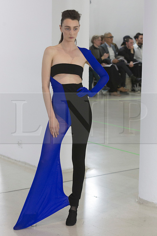 © Licensed to London News Pictures. 03/06/2015. London, UK. Collection by Fengyi Tan. A model walks the runway at the Royal College of Art (RCA) MA Fashion graduate fashion show.  Photo credit : Bettina Strenske/LNP