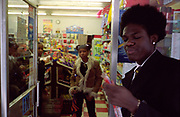 School children inside and outside a newsagents Lambeth Walk South London c.2000