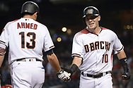 PHOENIX, AZ - JUNE 26:  Chris Herrmann #10 of the Arizona Diamondbacks is congratulated by Nick Ahmed #13 after hitting a solo home run during the first inning against the Philadelphia Phillies at Chase Field on June 26, 2017 in Phoenix, Arizona.  (Photo by Jennifer Stewart/Getty Images)