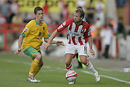 London - Saturday August 15th, 2009: Adam Drury (L) of Norwich City in action against Marcus Stewart of Exeter City during the Coca Cola League One match at St James Park, Exeter. (Pic by Mark Chapman/Focus Images)