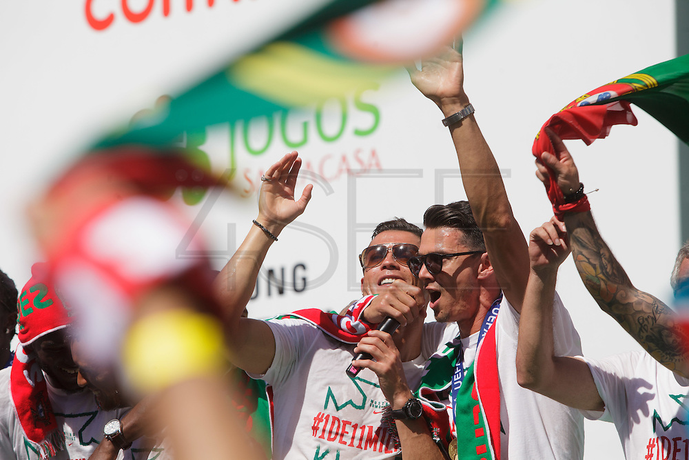 The portuguese team captain Cristiano Ronaldo and José Fonte singing with the crowd of portuguese supporters at Alameda Dom Afonso Henriques, in Lisbon. Portugal's national squad won the Euro Cup the day before, beating in the final France, the organizing country of the European Football Championship, in a match that ended 1-0 after extra-time.
