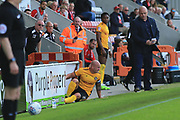 David Pipe of Newport County collides with an advertising board during the EFL Sky Bet League 2 match between Morecambe and Newport County at the Globe Arena, Morecambe, England on 16 September 2017. Photo by Mick Haynes.