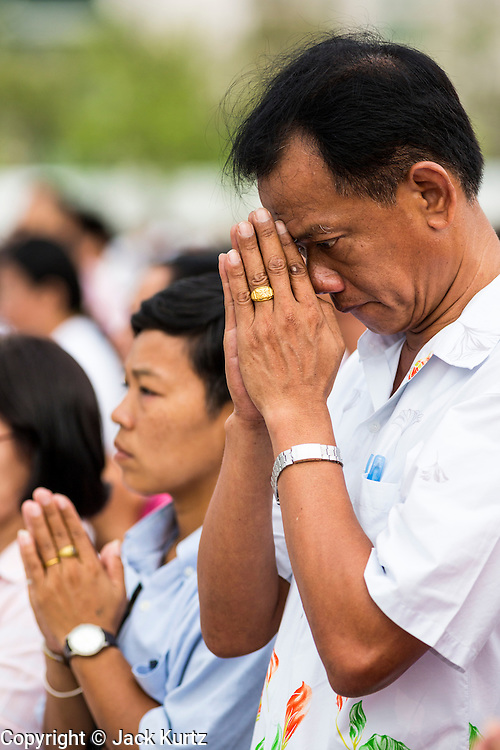 """23 APRIL 2013 - BANGKOK, THAILAND:  People pray during the opening ceremony to mark Bangkok as the World Book Capital City 2013. UNESCO awarded Bangkok the title. Bangkok is the 13th city to assume the title of """"World Book Capital"""", taking over from Yerevan, Armenia. Bangkok Governor Suhumbhand Paribatra announced plans that the Bangkok Metropolitan Administration (BMA) intends to encourage reading among Thais. The BMA runs 37 public libraries in the city and has modernised 14 of them. It plans to build 10 more public libraries every year. Port Harcourt, Nigeria will be the next World Book Capital in 2014. .PHOTO BY JACK KURTZ"""