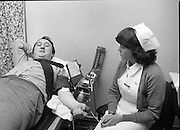 Blood Donors At The P.M.P.A.     (N50)..1980..13.11.1980..11.13.1980..13th November 1980..The mobile unit of the Blood Transfusion Service attended at the P.M.P.A.offices at Wolfe Tone Street, Dublin. It is part of a drive to encourage companies to allow employees time to donate blood. It is hoped that companies will avail of the facility of the mobile unit coming to them rather than having the staff off premises. Employees can donate blood and be back in their workplace within an hour using this facility..With Christmas on the horizon and a possible shortage of blood over this period more people are being encouraged to give blood. Contact The Blood Transfusion Service, Pelican House, Dublin for further details..Pictures show management and staff of P.M.P.A. donating blood in their head office in Wolfe Tone Street,Dublin using the mobile unit.