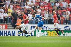 WIGAN, ENGLAND - Sunday, May 11, 2008: Manchester United's Rio Ferdinand and Wigan Athletic's Jason Koumas during the final Premiership match of the season at the JJB Stadium. (Photo by David Rawcliffe/Propaganda)