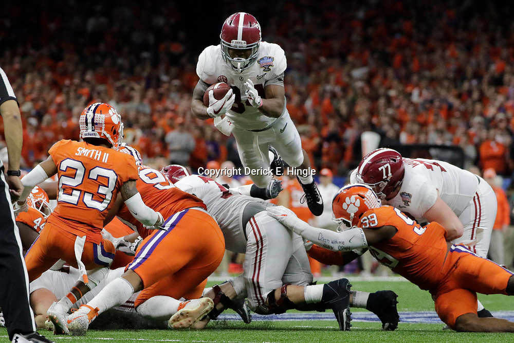 Jan 1, 2018; New Orleans, LA, USA; Alabama Crimson Tide running back Damien Harris (34) jumps during the third quarter against the Clemson Tigers in the 2018 Sugar Bowl college football playoff semifinal game at Mercedes-Benz Superdome. Mandatory Credit: Derick E. Hingle-USA TODAY Sports