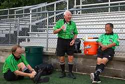 Soccer referee Aubrey Cashman, center, shares a laugh with colleagues Frank LaBoone, left, and Henry Woo during halftime of a soccer match between Lexington Catholic and Henry Clay, Tuesday, Aug. 13, 2013 at Lexington Catholic Soccer/Football Stadium in Lexington. Photo by Jonathan Palmer