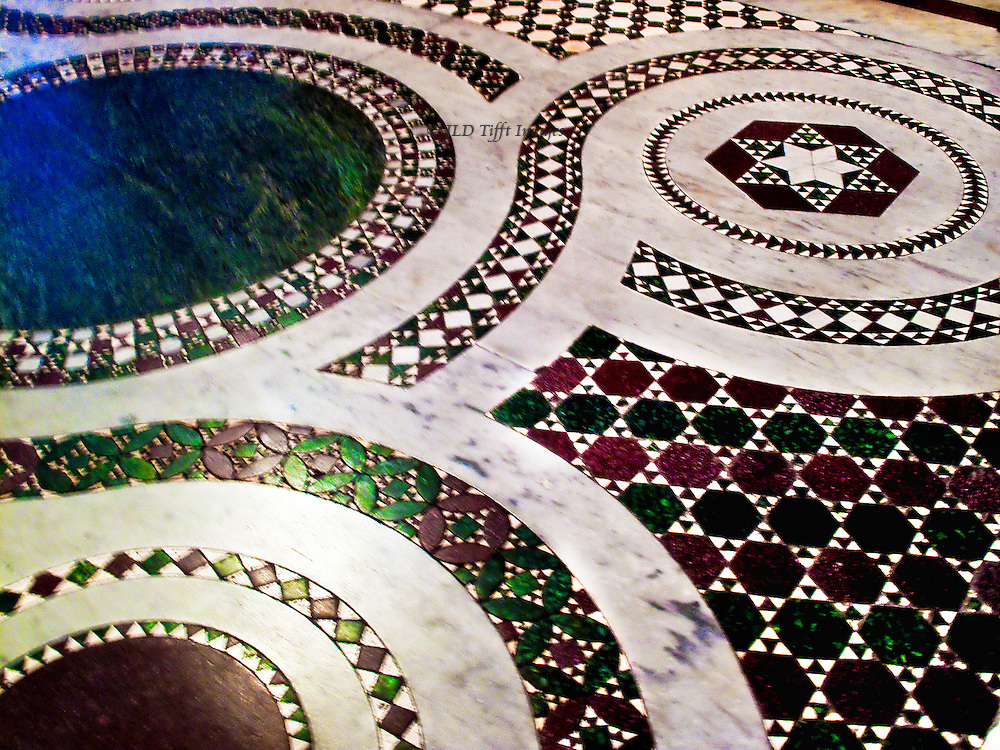 Santa Maria in Trastevere, interior.  Pavement detail, marble inlay in circle pattern.  Cosmati style floor.