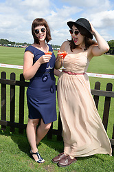 Left to right, actress ALEXANDRA ROACH and REMY BEASLEY at the Audi International Polo at Guards Polo Windsor Great Park, Egham, Surrey on 28th July 2013.