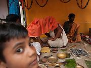 Boy's father teaches him the sacred Gayatri mantra (hymn)