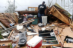 August 27, 2017 - Refugio, Texas, U.S. - JEREMY LEWIS, 30, looks for personal belongings in the debris of his mother's mobile home. The family evacuated to McAllen before the category four hurricane hit the area Friday night. The family returned on Sunday to find their home destroyed and his girlfriend's second floor apartment unit with water damage from a torn roof. (Credit Image: © Jerry Lara/San Antonio Express-News via ZUMA Wire)