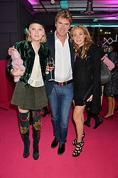 Left to right, SOPHIE DANIEL and PAUL & ANOUK DANIEL at Light Up Your Life - a party hosted by Lillingston held at Lights of Soho, 35 Brewer Street, London on 1st October 2015.