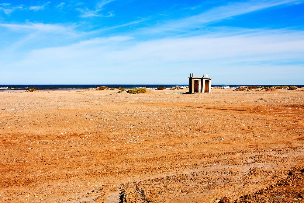 Derelict public toilets on a beach