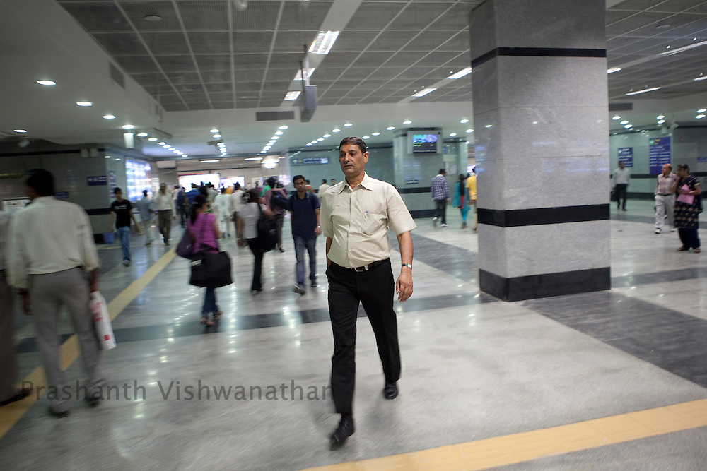 Veer Singh, 53 walks inside the Central Secratariat station as he uses the Delhi Metro network for his daily official travels in New Delhi, India, on Friday, October 22, 2010. Photographer: Prashanth Vishwanathan/HELSINGIN SANOMAT