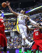 March 14, 2012; Indianapolis, IN, USA; Indiana Pacers small forward Danny Granger (33) reaches for a rebound against the Philadelphia 76ers at Bankers Life Fieldhouse. Indiana defeated Philadelphia 111-94. Mandatory credit: Michael Hickey-US PRESSWIRE