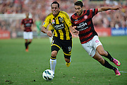10.03.2013 Sydney, Australia. Wellingtons midfielder Leo Bertos and Wanderers defender Adam D'Apuzzo in action during the Hyundai A League game between Western Sydney Wanderers and Wellington Phoenix FC from the Parramatta Stadium. The Wanderers won 2-1.