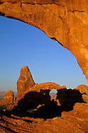 Sunrise light on North Window looking , toward Turret Arch, Windows Section Arches National Park, UTAH
