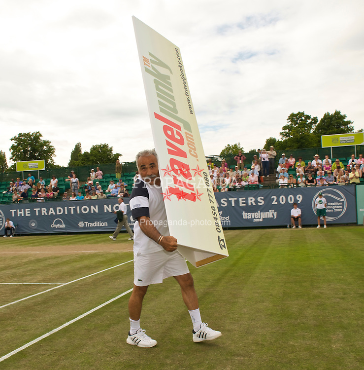 NOTTINGHAM, ENGLAND - Friday, June 12, 2009: Mansour Bahrami (IRN) walks off court with a Travel Junky advert on day two of the Tradition Nottingham Masters tennis event at the Nottingham Tennis Centre. (Pic by David Rawcliffe/Propaganda)