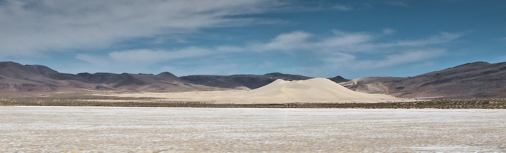Sand Mountain is a Singing sand dune 20 mi east of Fallon, Nevada along U.S. Route 50. The dune is two miles long and 600 ft high. It lies on the edge of the ancient Lake Lahontan  panorama