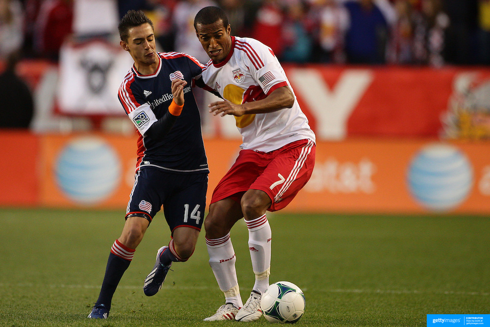 Roy Miller, (right), New York Red Bulls, is challenged by Diego Fagundez, New England Revolution, during the New York Red Bulls V New England Revolution, Major League Soccer regular season match at Red Bull Arena, Harrison, New Jersey. USA. 20th April 2013. Photo Tim Clayton