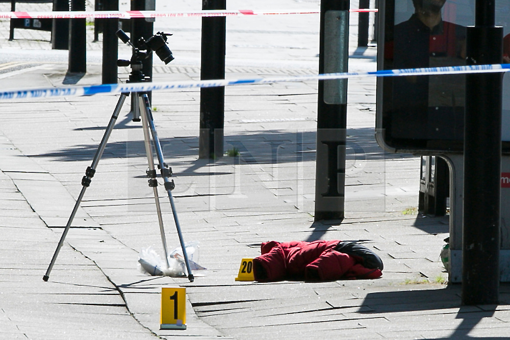 © Licensed to London News Pictures. 01/09/2018. London, UK. Evidence markers placed next to clothing at the Scene on Caledonian Road in London where a woman in her 20's has been stabbed in broad daylight. Police were called to the scene shortly before 10.30am today. Photo credit: Dinendra Haria/LNP