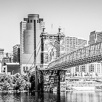 Cincinnati skyline panorama photography in black and white. Panoramic photo ratio is 1:3. Picture includes Cincinnati skyline, John A. Roebling bridge, and downtown city office buildings with Great American Insurance Group Tower, Omnicare building, Scripps Center building, PNC Tower Building, Carew Tower, US Bank Building, and Fifth Third Bank building.
