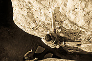 A rock climber climbing at Lizards Mouth bouldering area, Santa Barbara, California.  (releasecode:  jk_mr1011, jk_mr1012) (Model Released)
