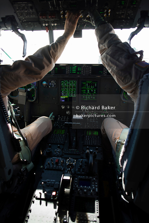 The cockpit of a Lockheed Martin-built C-130J Hercules airlifter. Externally similar to the classic Hercules in general appearance, the J model sports considerably updated technology. These differences include new Rolls-Royce AE 2100 D3 turboprops with Dowty R391 composite scimitar propellers, digital avionics (including Head-Up Displays (HUDs) for each pilot). During more than 50 years of service the Hercules family has the longest continuous production run of any military aircraft in history. Strategic, automated low-level airdrops keep 60 road transport vehicles and up to 120 supple troops off hostile roads using only three flight crew.