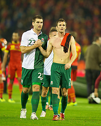 BRUSSELS, BELGIUM - Tuesday, October 15, 2013: Wales' Sam Vokes and Andy King after the 1-1 draw with Belgium during the 2014 FIFA World Cup Brazil Qualifying Group A match at the Koning Boudewijnstadion. (Pic by David Rawcliffe/Propaganda)