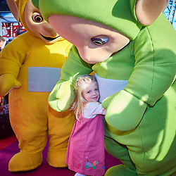 © Licensed to London News Pictures. 24/01/2017. LONDON, UK.  Toy Fair 2017 trade exhibition at Olympia.   In this picture: Lucy (aged 2) with the Teletubbies which launched 20 years ago.  Taken with permission of parent but surname not given. Photo credit: Cliff Hide/LNP