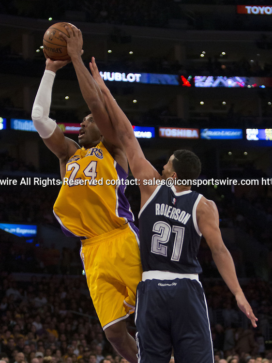 Dec. 19, 2014 - Los Angeles, California, U.S - Kobe Bryant #24 of the Los Angeles Lakers goes for a basket during their game with the Oklahoma City Thunder. Los Angeles Lakers lose to the visiting Oklahoma City Thunder 104-103, on Friday December 19, 2014 at the Staples Center in Los Angeles, California