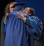 Congresswoman Shelia Jackson Lee congratulates graduates during the first ever graduation for Mickey Leland College Preparatory Academy, May 27, 2015.