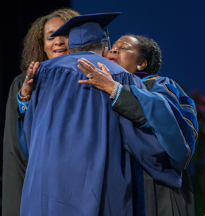Congresswoman Shelia Jackson Lee congratulates graduates during the first ever graduation for Mickey Leland College Preparatory Academy, May 27, 2015.