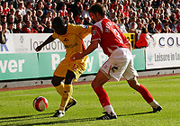 Photo: Olly Greenwood.<br />Charlton Athletic v Watford. The Barclays Premiership. 21/10/2006. Watford's Lloyd Doyley tries to get past Charlton's Hermann Hreidarsson.