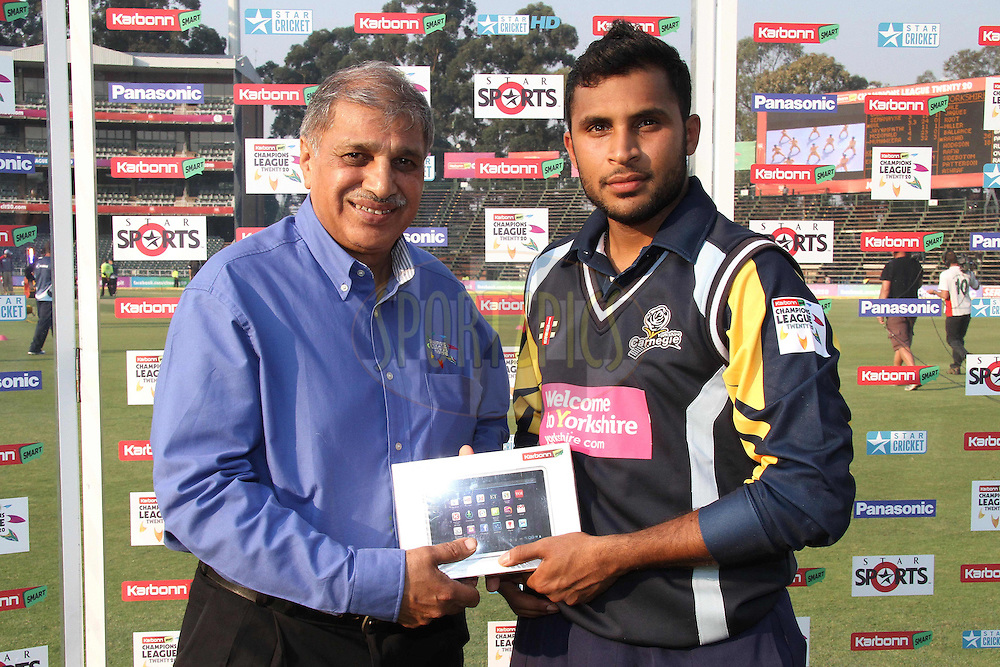 Mr Cassim Docrat - Chief Executive Officer of Gauteng Cricket Board hands the Man of the Match Award to Adil Rashid of Yorkshire Carnegie during 1st Qualifying match of the Karbonn Smart CLT20 South Africa between Uva Next and Yorkshire held at The Wanderers Stadium in Johannesburg, South Africa on the 9th October 2012..Photo by Shaun Roy/SPORTZPICS/CLT20