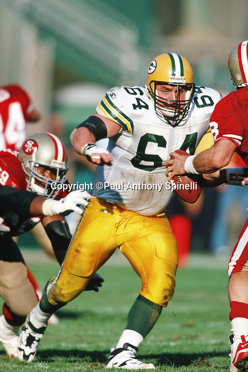 Green Bay Packers nose tackle John Jurkovic (64) chases the action during the NFL NFC Divisional Playoff football game against the San Francisco 49ers on Jan. 6, 1996 in San Francisco. The Packers won the game 27-17. (©Paul Anthony Spinelli)