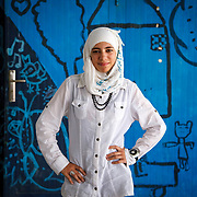 Basma, 15, and her family left Homs, Syria for the safety of Jordan June 12, 2014. She is wearing the watch her uncle's wife gave her for her birthday and for a parting gift, as she was leaving for safety in Lebanon.<br />
