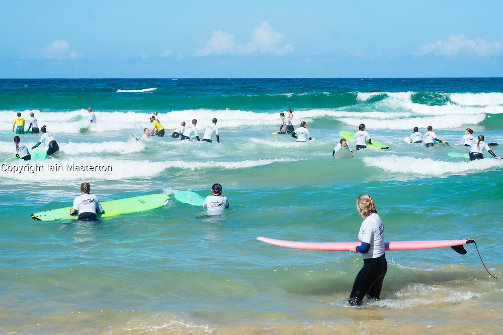 Surfers in a surfing lesson at Manly Beach in Australia