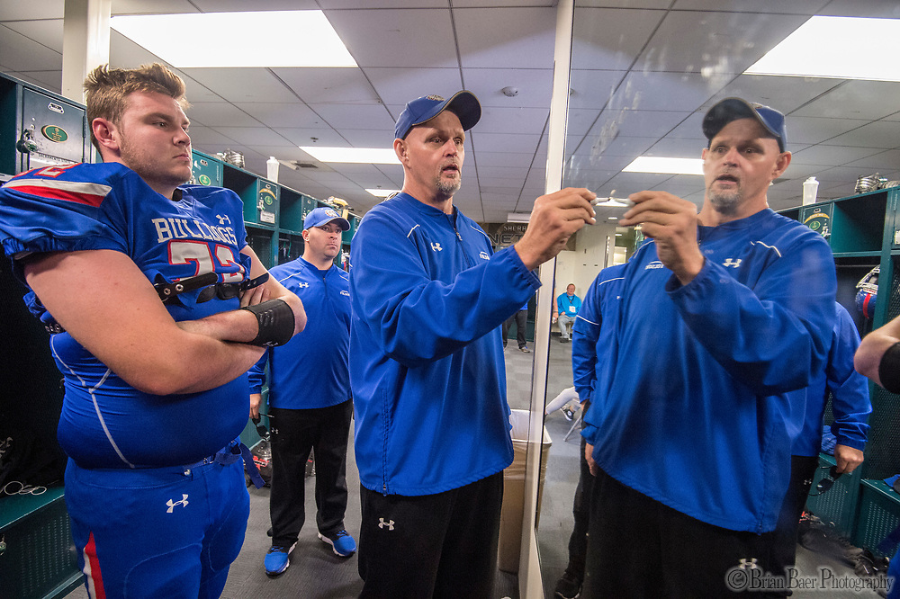 Folsom Bulldogs head coach Kris Richardson, draws up a play on the mirror inside the locker room before the game as the Folsom Bulldogs play the St. Mary's Rams in the Sac-Joaquin Section Division I championship game at Hornet Stadium at Sacramento State, Saturday Dec 2, 2017. <br /> photo by Brian Baer