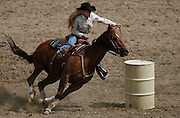 061508-Evergreen, CO-barrellracing-Barrel racer Jill Kadrie cuts a close turn around the last barrel during the barrel racing competition Sunday, June 15, 2008 at the Evergreen Rodeo Grounds..Photo By Matthew Jonas/Evergreen Newspapers/Photo Editor