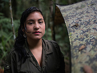 Yira, a FARC rebel, outside of her tent in a camp in the remote Putumayo region of Colombia, on December 11, 2016. (Photo/Scott Dalton)