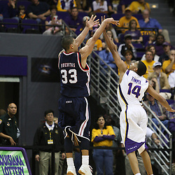 14 February 2009: David Huertas (33) shoots over LSU guard Garrett Temple (14) during a NCAA basketball game between SEC rivals the Ole Miss Rebels and the LSU Tigers at the Pete Maravich Assembly Center in Baton Rouge, LA.