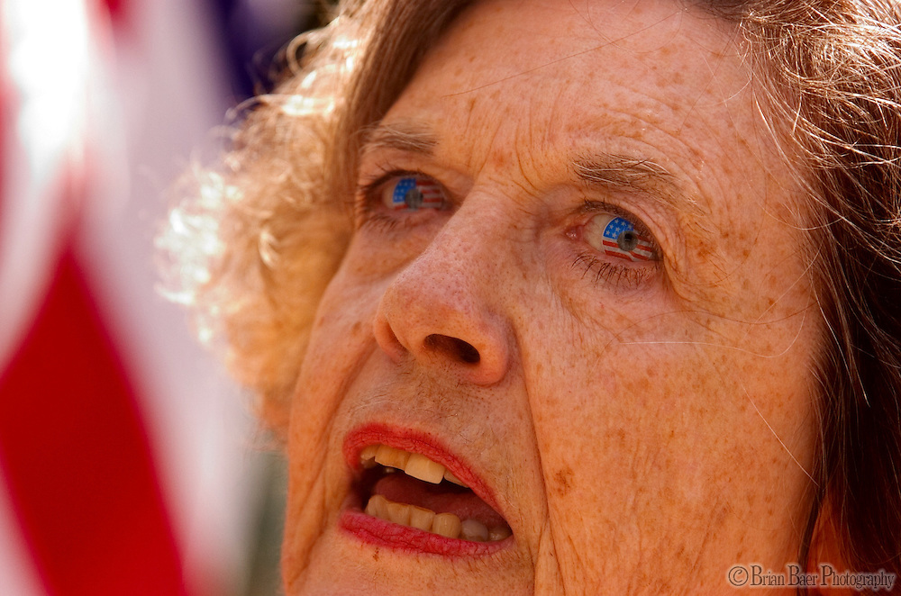 Roberta Allen wears flag colored contact lenses as she and others protest the visit of Mexican President Vicente Fox outside the State Capitol, Thursday May 25 2006.