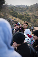 Having just landed in a small boat from Turkey, an Iraqi father and his four-year-old daughter (Sara) from Mosul stand on a road near the village of Efthalou on the north coast of the Greek island of Lesbos. They are among more than 500,000 migrants and refugees who have crossed from Turkey to the Greek islands in 2015.